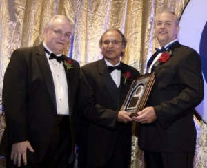 Andy Chatha (centre) was created an Honorary member of ISA in 2011 flanked by ISA Presidents Jerry Cockrell (2009) and Leo Staples (2011)